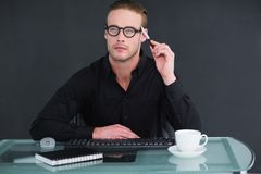 Thoughtful businessman working at his desk Stock Image