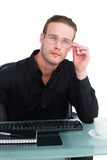 Thoughtful businessman working at his desk Stock Photos