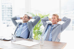 Thoughtful businessmen looking away Stock Photo