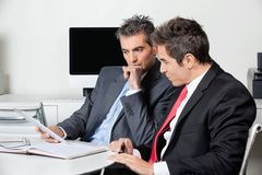 Thoughtful Businessmen Using Digital Tablet At Stock Photo