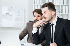 Thoughtful businesspeople discussing project Stock Images