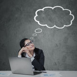 Thoughtful businessperson with cloud tag Royalty Free Stock Photo