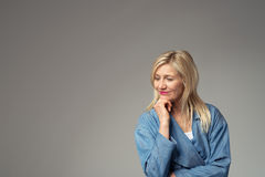 Thoughtful Businesswoman Against Gray Background Stock Photos