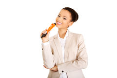 Thoughtful businesswoman with big pen. Stock Images