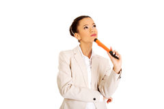 Thoughtful businesswoman with big pen. Stock Photos