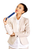 Thoughtful businesswoman with big pencil. Stock Photos