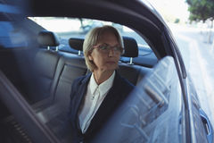 Thoughtful businesswoman in car Royalty Free Stock Photography