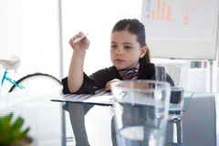 Thoughtful businesswoman at desk Royalty Free Stock Photo