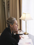 Thoughtful Businesswoman With Documents At Desk Royalty Free Stock Photos