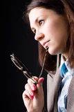 Thoughtful businesswoman with eyeglasses Stock Photos