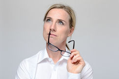 Thoughtful businesswoman with eyeglasses Stock Images
