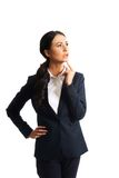 Thoughtful businesswoman with a finger under chin Stock Images