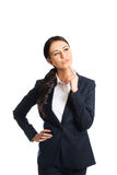 Thoughtful businesswoman with a finger under chin Royalty Free Stock Image