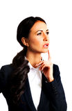 Thoughtful businesswoman with finger under chin Royalty Free Stock Photography