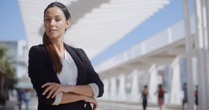 Thoughtful businesswoman with folded arms Royalty Free Stock Image
