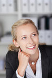 Thoughtful Businesswoman With Hand On Chin Looking Away Stock Images