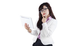 Thoughtful businesswoman holding digital tablet 2 Royalty Free Stock Image