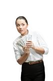 Thoughtful businesswoman holding money Stock Image