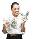 Thoughtful businesswoman holding money Stock Image