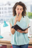 Thoughtful businesswoman holding a notebook Stock Photos