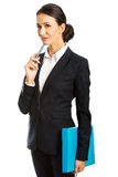 Thoughtful businesswoman holding a pen Royalty Free Stock Photo