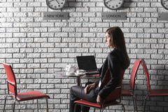 Thoughtful Businesswoman With Laptop In Cafe Royalty Free Stock Images