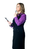 Thoughtful businesswoman looking away Stock Photo