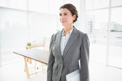 Thoughtful businesswoman looking away Stock Photos