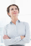 Thoughtful businesswoman looking away Stock Image
