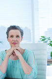 Thoughtful businesswoman looking at the camera Royalty Free Stock Photo