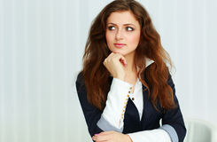 Thoughtful businesswoman looking right at copyspace Royalty Free Stock Photos