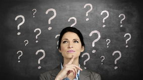 Thoughtful businesswoman looking up. Against question marks stock footage