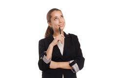Thoughtful businesswoman looking up isolated Stock Image
