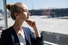 Thoughtful businesswoman looking through window Royalty Free Stock Images