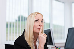 Thoughtful businesswoman making decisions Stock Photography