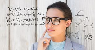 Thoughtful businesswoman with math equation. Digital composite of Thoughtful businesswoman with math equation royalty free stock photography