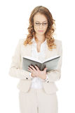 Thoughtful businesswoman with note. Royalty Free Stock Photo