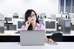 Thoughtful businesswoman in office 1 Stock Photography