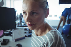 Thoughtful businesswoman at office desk Stock Image