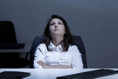Thoughtful businesswoman in the office Stock Photo