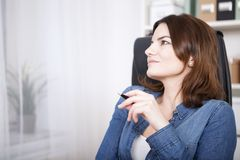 Thoughtful Businesswoman Sitting on her Chair Royalty Free Stock Image