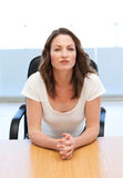 Thoughtful businesswoman sitting at a table Stock Image