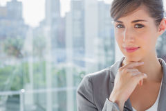 Thoughtful businesswoman smiling at camera Stock Images