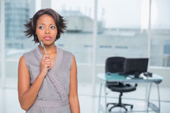 Thoughtful businesswoman standing in her office Stock Photo