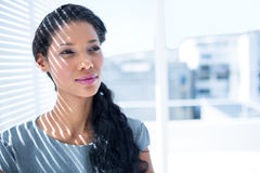 Thoughtful businesswoman standing in the office Royalty Free Stock Photos