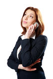 Thoughtful businesswoman talking on the phone Stock Photography