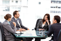 Thoughtful businesswoman talking to her team Royalty Free Stock Photos