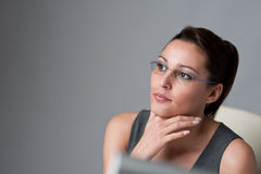 Thoughtful businesswoman thinking at office. Successful executive businesswoman thinking at office Stock Photography