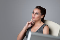 Thoughtful businesswoman thinking at office Stock Image