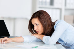 Thoughtful businesswoman at work Royalty Free Stock Photos